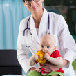 Beautiful female doctor with little baby patient — Stock Photo #49613877