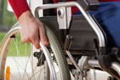 Close-up on wheelchair of capable disabled — Stock Photo