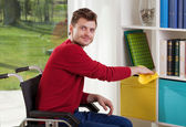 Capable of disabled man wipes the dust  — Stock Photo