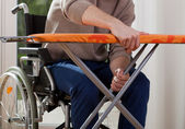 Disabled breaks down ironing board — Stock Photo