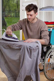Disabled ironing shirts on board — Stock Photo