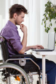 Disabled man using a laptop  — Stock Photo