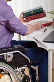 A disabled man sitting and learns — Stock Photo