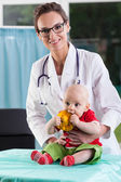 Beautiful female doctor with little baby patient — Stock Photo