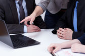 Analyzing computer data on business meeting — Foto Stock