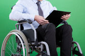 Disabled businessman with documents — Stock Photo
