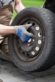 Close-up of a changing a car wheel — Stock Photo