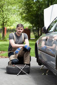 Handsome man repairing car outdoors — Stock Photo