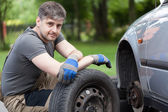 Car mechanic working outdoors — Stock Photo