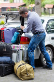 Man packing car for vacation — Stock Photo