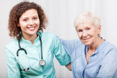 Nurse caring about senior lady — Stock Photo