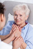 Nurse comforting elderly woman — Stock Photo