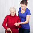Granddaughter helping grandmother — Stock Photo #49720021