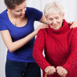 Young woman helping elderly lady — Stock Photo #49720059