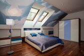 Interior of blue and white bedroom — Stock Photo