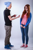 Boy giving girl a joint — Stockfoto