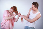 Boy pulling girl hair — Stock Photo
