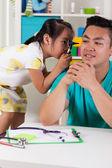 Girl having fun with dad — Stockfoto