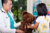 Teddy bear during examination — Stock Photo