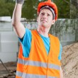 Manual worker showing thumbs up sign — Stock Photo
