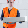 Construction worker with a brick — Stock Photo #50025793