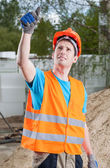 Manual worker showing thumbs up sign — Foto Stock