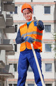 Builder showing thumbs up sign — Stock fotografie