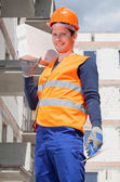 Bricklayer holding a brick — Stock Photo