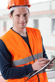 Inspector with clipboard at building site — Stock Photo
