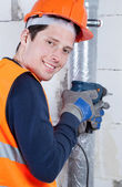 Young builder with drill in hands — Foto Stock