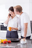 Business couple in the kitchen — Stock Photo