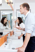 Busy couple in a bathroom — Stock Photo