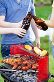 Friends grilling and drinking beer — Stock Photo