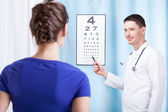 Doctor checking patient vision — Stock Photo