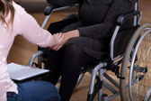 Therapist comforting disabled woman — Stock Photo