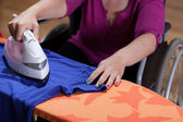 Disabled woman during ironing — Foto de Stock