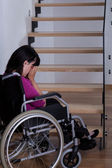 Disabled woman in front of stairs — Stock Photo