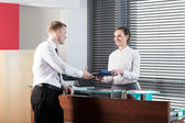 Female receptionist and businessman — Stock Photo