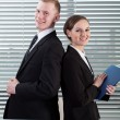 Office workers standing back to back — Stock Photo #50310285