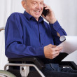 Disabled man talking on phone — Stock Photo
