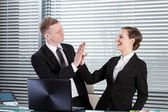 Business people giving high five — Stockfoto