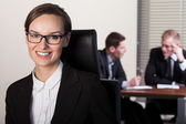 Businesswoman and co-workers — Stock Photo