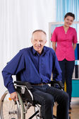 Happy old and disabled man — Stockfoto