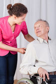 Disabled talking with a nurse  — Stock Photo