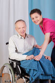 Disabled and a nurse smiling — ストック写真
