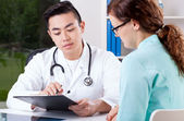 Doctor and nurse consultation — Stockfoto