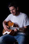 Male guitarist with guitar — Stock Photo