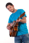 Guitar player on white background — Stockfoto