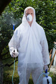 Gardener with insect spray  — Stock Photo