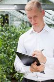 Garden expert in greenhouse — Stock Photo